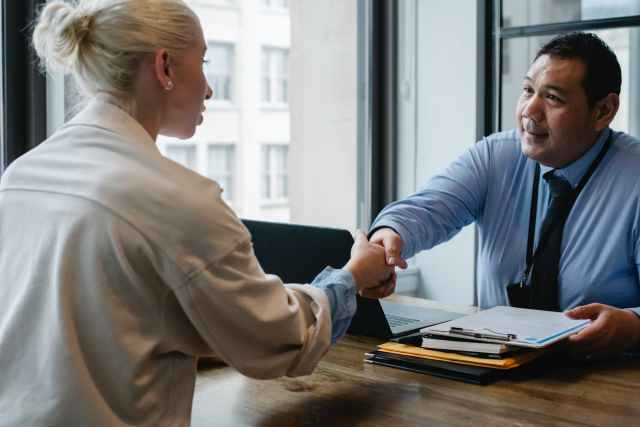 Develop soft skills ethnic businessman shaking hand of applicant in office