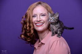 Woman with kitten on shoulder - kitten adoption DC