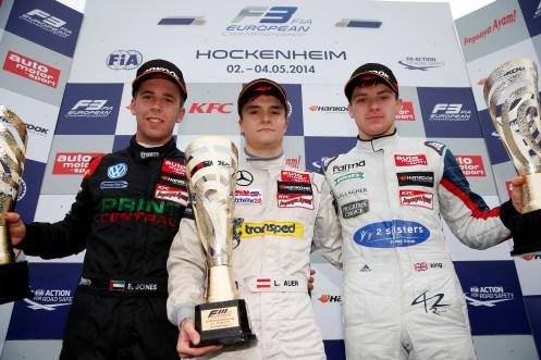 Auer centred the podium celebrations. © FIA.