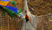 Locals commuting on the Punakha suspension bridge built on Po chu river. Photo: Kaushik Naik.