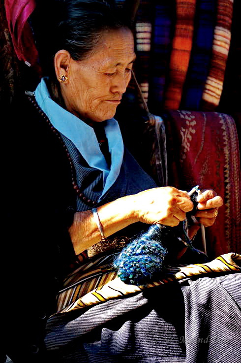 Knitting is a favourite pass-time for the shopkeepers while they wait for tourists. Photo: Milind Date.