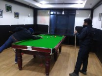 In spite of the freezing hands, Sanjay and Abhishek have enough enthusiasm to play a few rounds of pool at The Tethys Narkanda