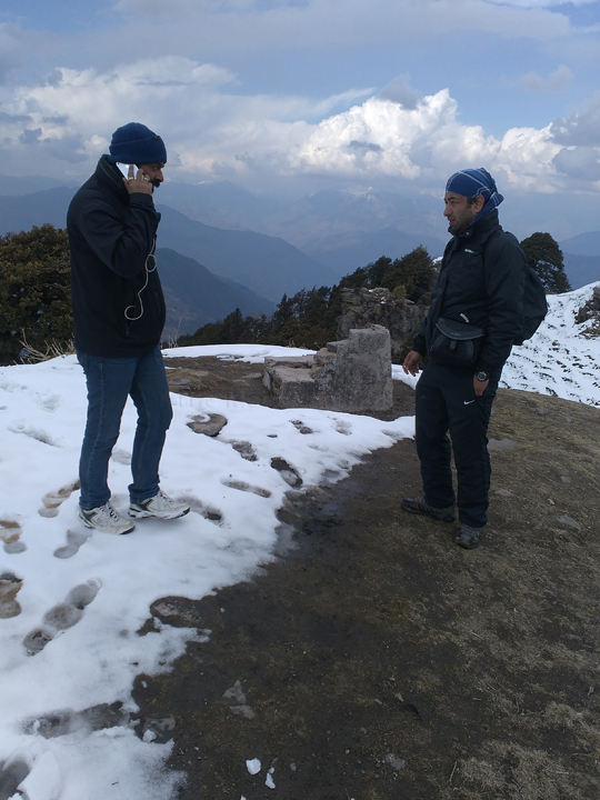 Abhishek doesn't seem very happy with Sanjay's Skype call interrupting Mountain Walking affairs atop Hatu Peak