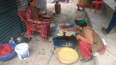 Ladies preparing the local bread on a flat griddle.