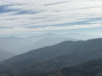 View of the Churdhar mountains through a hazy afternoon sky (Churdhaar is right in the middle on the last ridge visible); Photo: Abhinav Kaushal