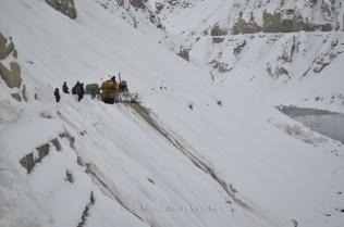 The courageous Bulldozer operator pushing down the excess snow on the road. Photo; Abhinav Kaushal