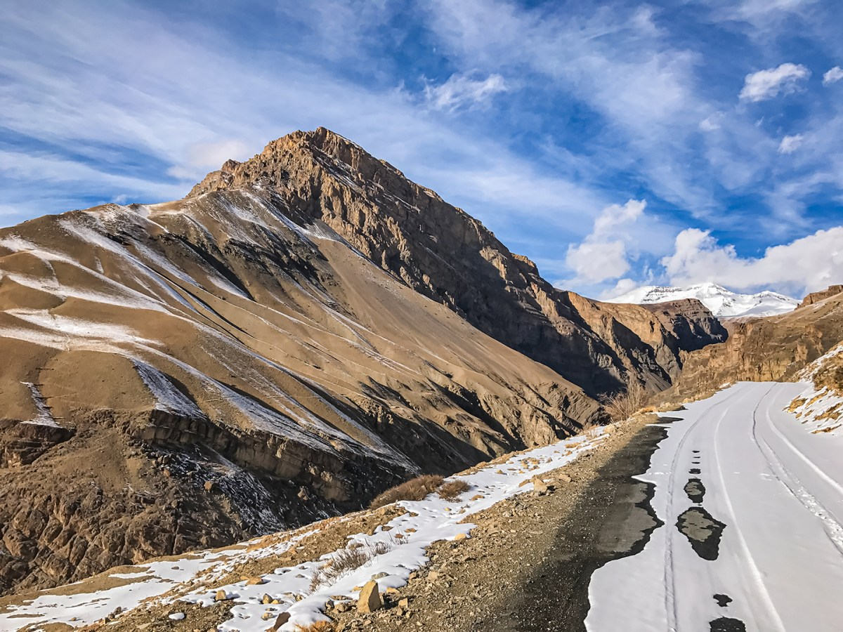'Spiti Winter Kaza Langza Road' by Sanjay Mukherjee illustrates the winter view of the intriguing and equally dangerous road from Kaza to Langza in Spiti Valley.
