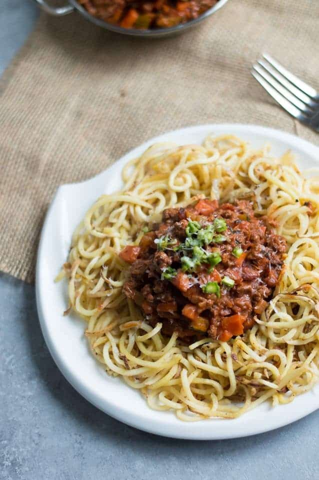 Sweet Potato Noodles with Beef Bolognese. This recipe is gluten free, grain free & dairy free. Healthy carbs and delicious, nourishing protein and fats for you. TheMovementMenu.com
