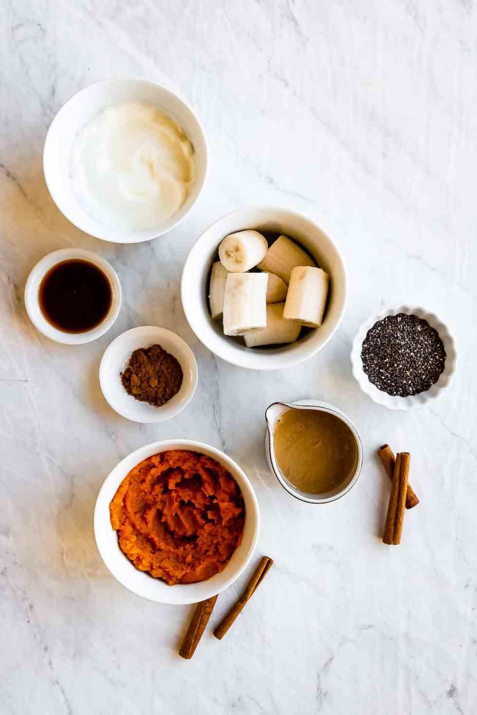 ingredients in bowls to make pumpkin smoothie
