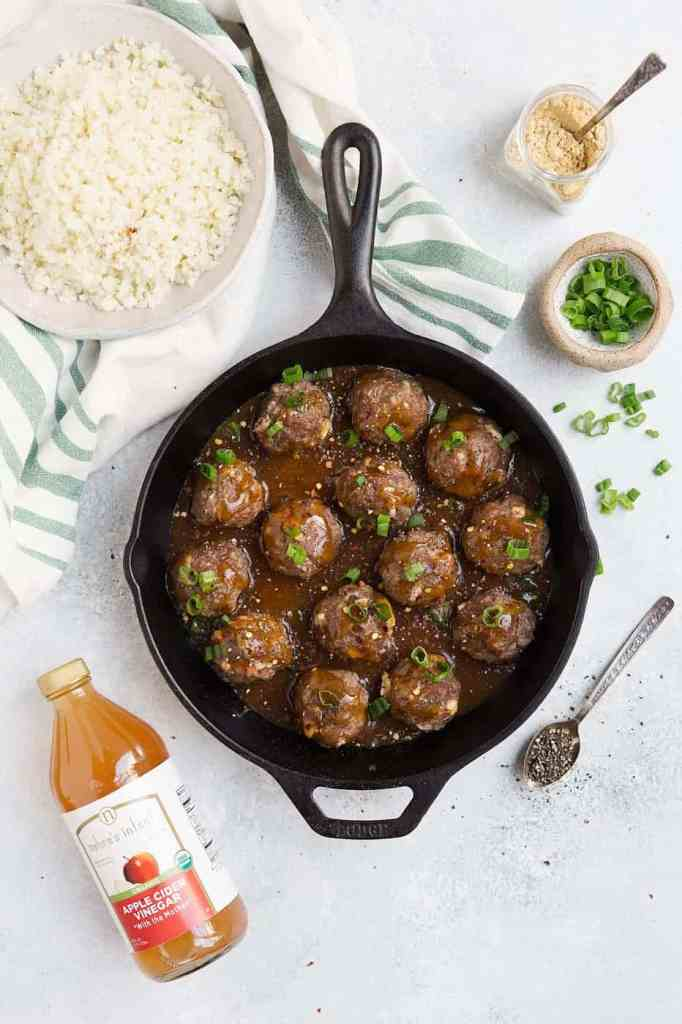 Whole30 cauliflower rice meatballs in a cast iron skillet