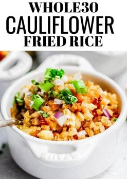 cauliflower fried rice in a white bowl with a spoon inside
