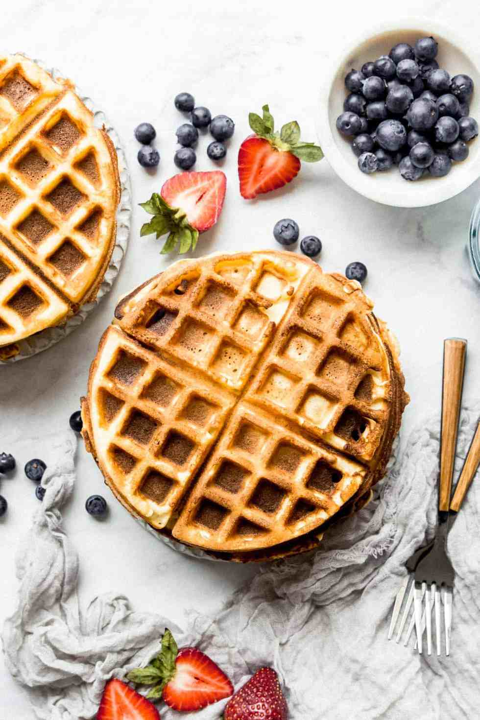 plain paleo waffles on a plate with blueberries on the side