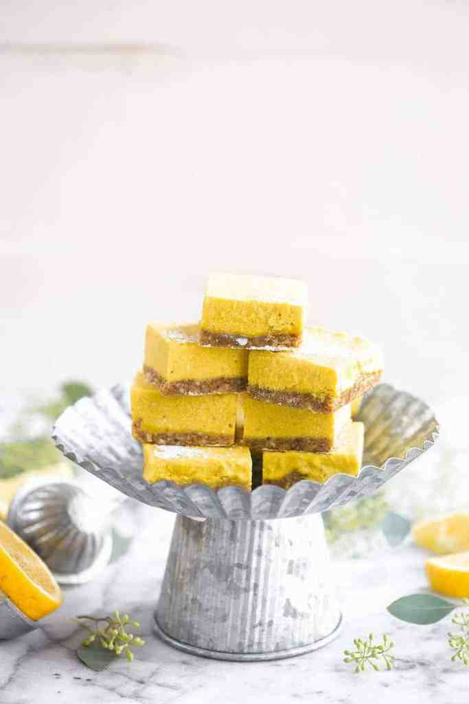 stack of paleo lemon bars on a cake stand