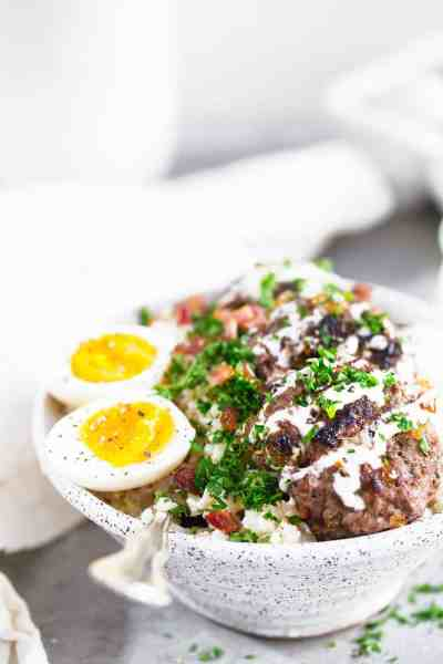 Whole30 Beef and Bacon Breakfast Bowl. THE BEST beef and bacon breakfast bowl! Loaded up with fresh herbs, soft boiled eggs, a creamy tahini sauce & laid on a bed of cauliflower rice. whole30 breakfast recipe. whole30 bowl recipe. whole30 breakfast bowl. whole30 beef recipes. whole30 meal plan. Easy whole30 dinner recipes. Easy whole30 breakfast recipes. Whole30 recipes. Whole30 lunch. Whole30 meal planning. Whole30 meal prep. Healthy paleo meals. Healthy Whole30 recipes. Easy Whole30 recipes.