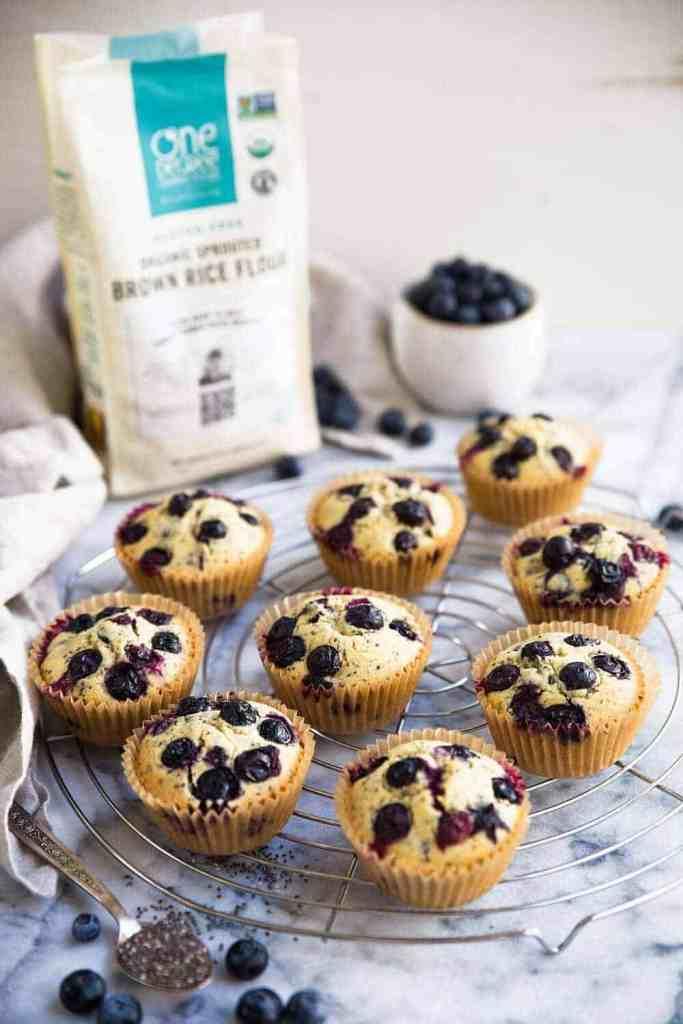 gluten free vegan blueberry muffins on a circular wire rack