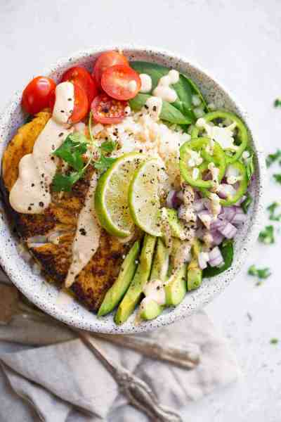 This recipe for Paleo Fish Taco Bowls will leave you wanting more! Healthy whole30 fish taco bowl that is served on a bed of lettuce and cauliflower rice, topped off with a creamy chipotle sauce! Only 10 minutes to prepare! whole30 meal plan. Easy whole30 dinner recipes. Whole30 recipes. Whole30 lunch. Whole30 meal planning. Whole30 meal prep. Healthy paleo meals. Healthy Whole30 recipes. Easy Whole30 recipes. Easy whole30 dinner recipes...