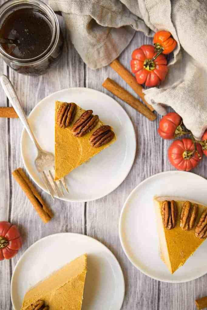 A no bake easy vegan pumpkin cheesecake. This dairy free cheesecake has a delicious raw crust, creamy pumpkin cashew center and the most decadent vegan caramel sauce on top! #pumpkin #vegancheesecake #nobake #vegan #cheesecake