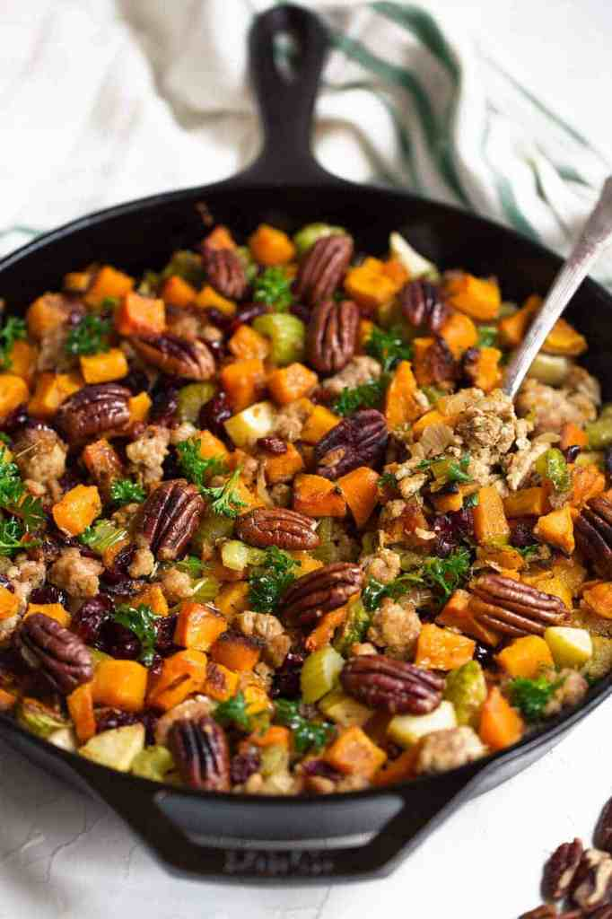 This gluten free stuffing recipe is not set up like your average Thanksgiving stuffing. It is loaded up with all kinds of nutrient dense vegetables like butternut squash, celery and brussels sprouts and tossed with dried cranberries and toasted pecans. It's perfect as a side dish or as a main course, as it's very nutritious and filling. Tangy, a little bit sweet, paleo, whole30 compliant and can be made vegan, too!