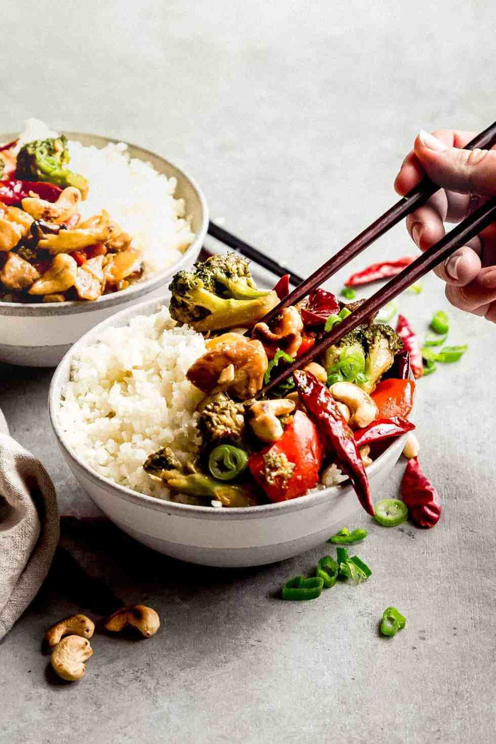cashew chicken in bowls with chopsticks