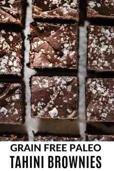 close up photo of tahini brownies with chocolate and flaked salt