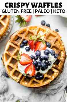 waffles on a plate with berries on top
