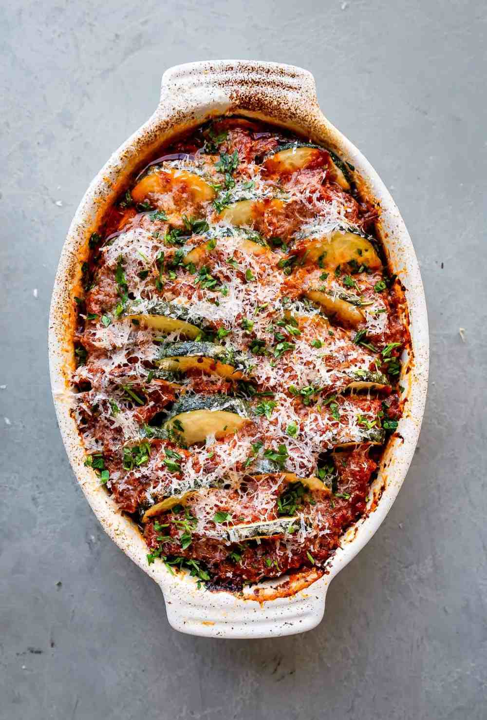 low carb zucchini casserole with red sauce and parmesan cheese on top