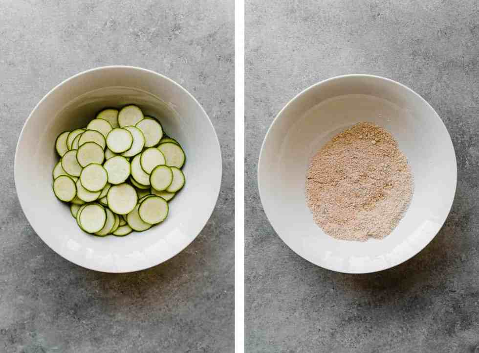sliced zucchini in a bowl and seasoning in a bowl for air fryer chips