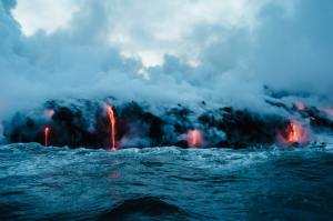 Lava dripping into the ocean.