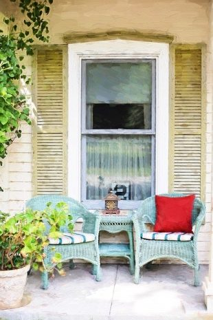 Two chairs on a small porch.