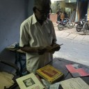 Murugan Chettiar, the present owner of Chettiar Press, leafing through a book published in the 1960s.