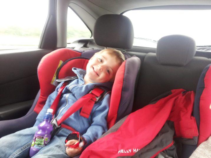 Child sitting in car seat