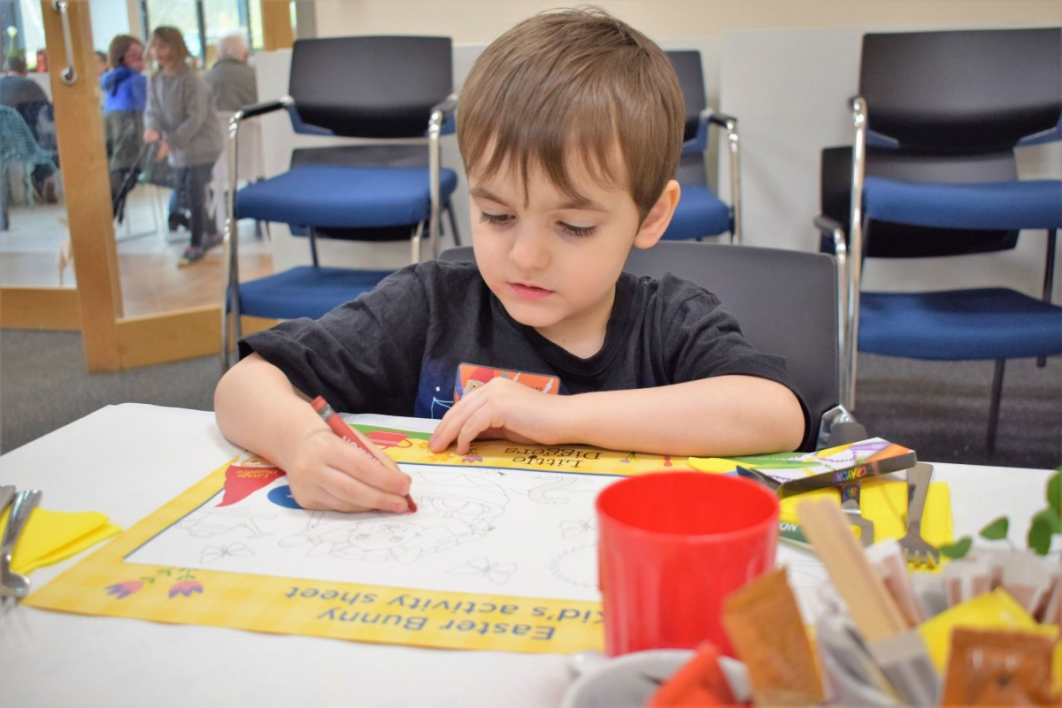 Arthur completing the Easter activity worksheet - Wyevale Garden Centre