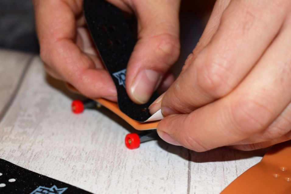 applying the grip on the Tech Deck 96MM Skateboard