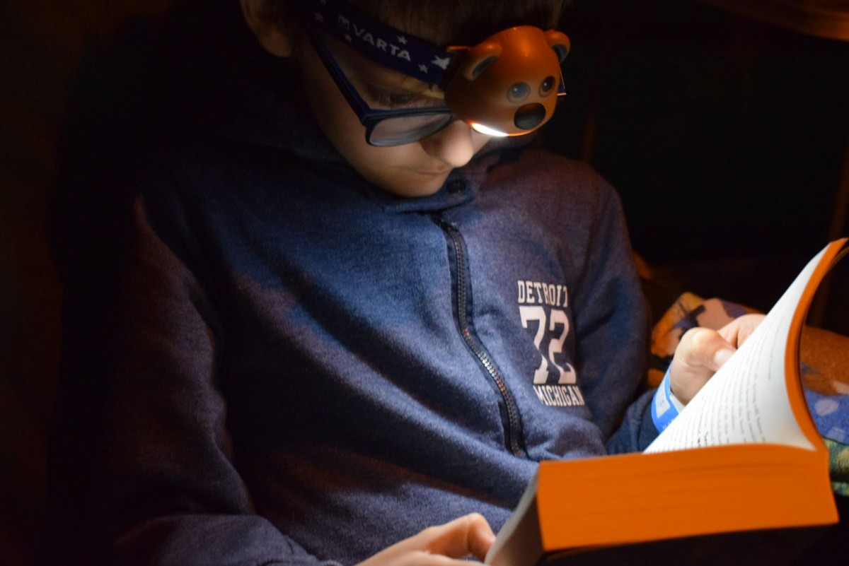 Jack reading a book using a VARTA head torch