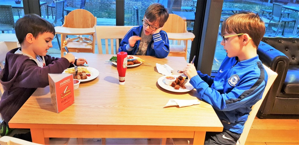 Boys eating their evening meal at YHA York