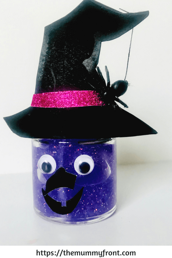 Halloween Slime - The best halloween slime jar tutorial, showing you how to make slime, how to store slime & more | halloween craft ideas | easy halloween craft | halloween slime | witch slime | spooky slime | black cat halloween | purple slime #halloweenslime #halloweencraft #halloweendiy #halloweencraftforkids