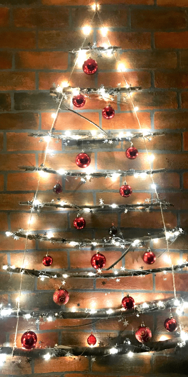 How To Make This DIY Stunning Twig Christmas Tree You Can Make In Less Than 30 Minutes | DIY Christmas Decorations | Rustic Christmas tree | DIY Christmas tree Via https://themummyfront.com #christmastreeideas #christmastree #diychristmascrafts #diychristmasdecorations #rusticdecorations #farmhousechristmasdecor #rusticchristmasdecor