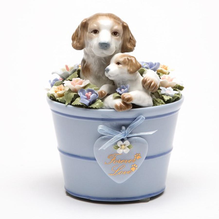 Porcelain puppies in flower pot