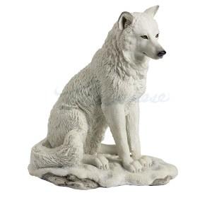 White Wolf sitting in snow figurine