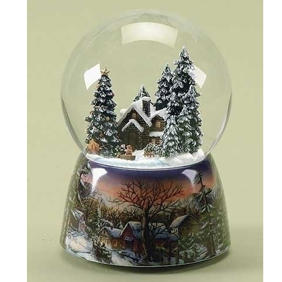 Beautiful winter scene porcelain musical base and a snow globe with a house and a boat on a pond inside the globe
