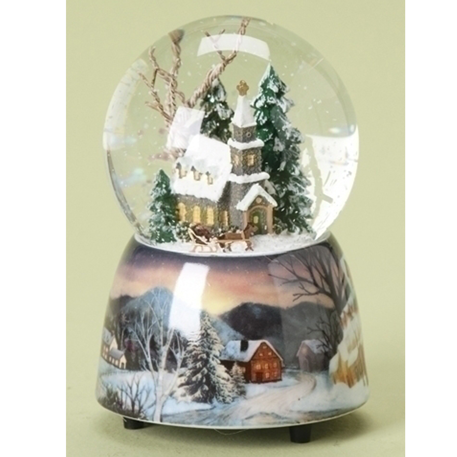 Musical Snow Globe with a church scene inside and a beautiful porcelain base