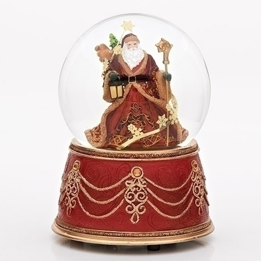Musical Victorian Santa inside a snow globe with a red and gold base