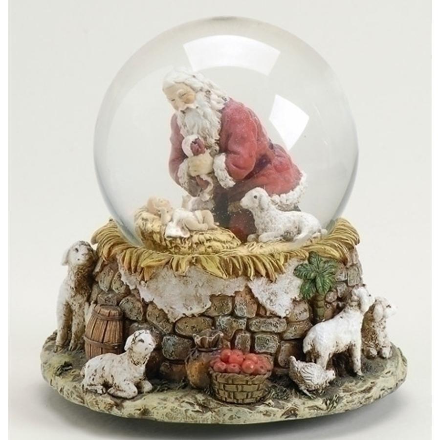 Santa kneeling by manger with animals musical globe