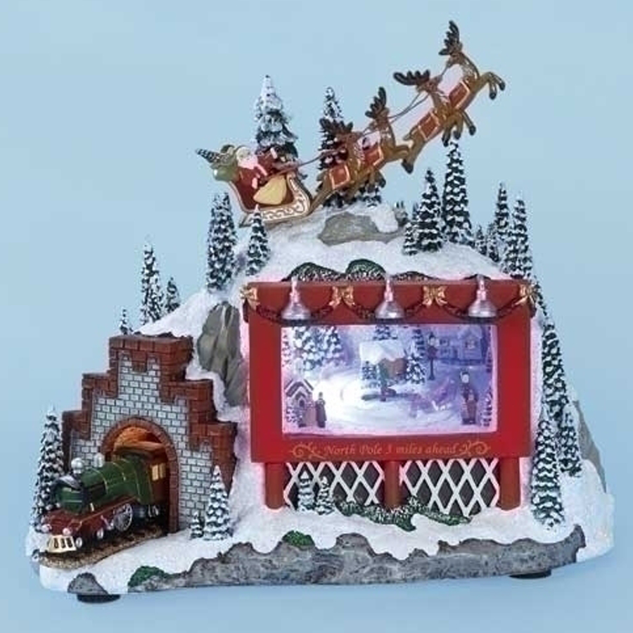 Santa and Reindeer over lighted scene with train