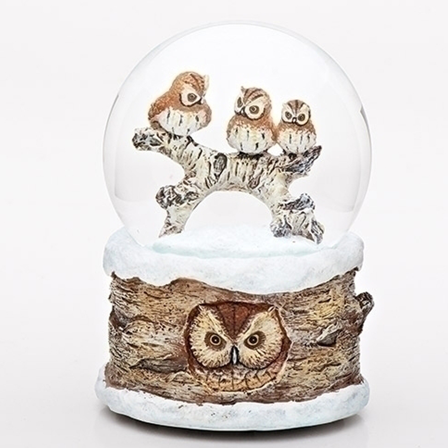 Three owls inside a snowy water globe. Birch looking base with an owl peering out. Musical