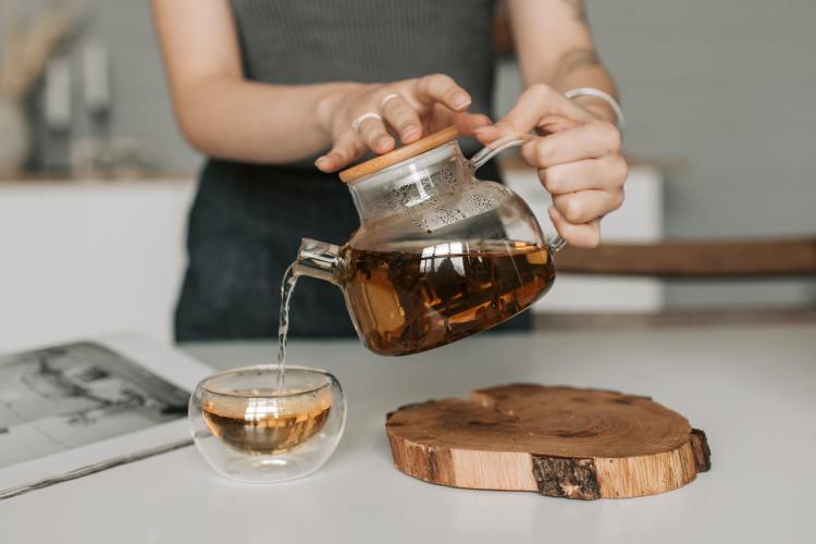 woman pouring herbal tea