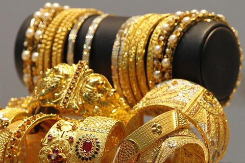 Gold falls Rs 26, silver declines Rs 201