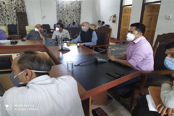 Hasnain Masoodi chairs meeting of officers in Dak bungalow Anantnag
