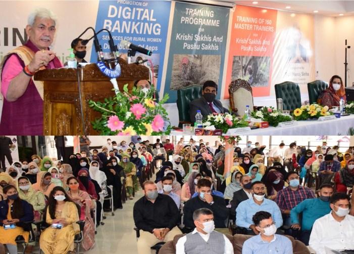 LG Sinha distributes 80 Aadhar Enabled Payment System under JKRLM