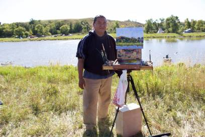 Monty Singer, artist from Albuquerque, New Mexico, paints by the Cannonball River (Photo: Nadya Tannous)